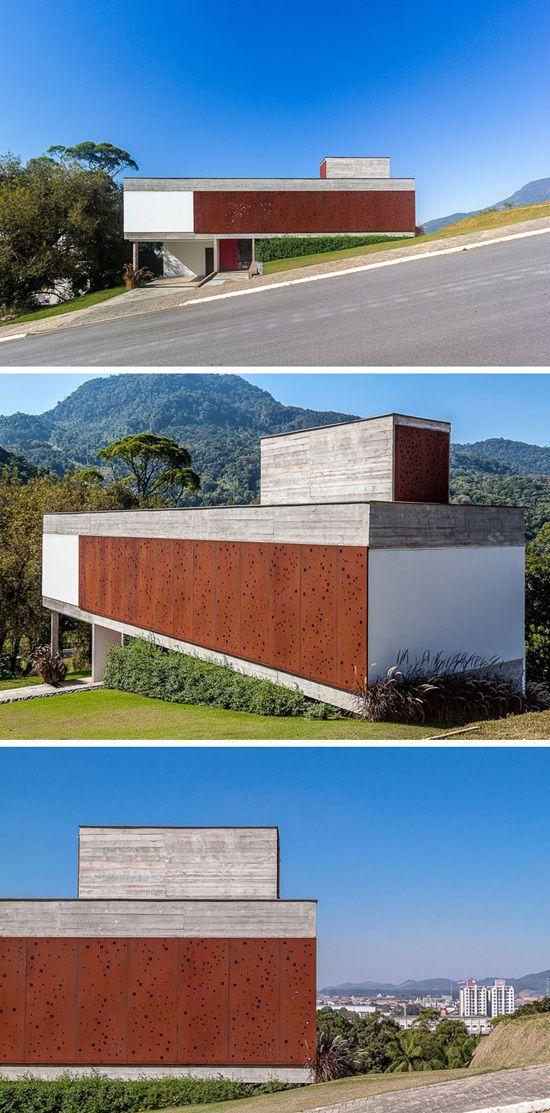 Casa modulara cu fatada perforata